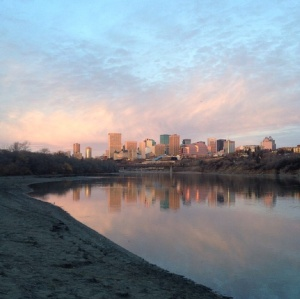 view of downtown Edmonton at sunrise from the trails